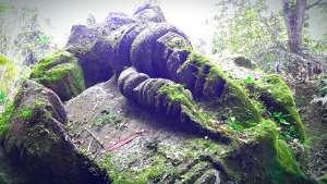 fallen statue at goa gajah
