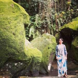 Pura Goa Gajah site, Bali, Indonesia - fallen statue