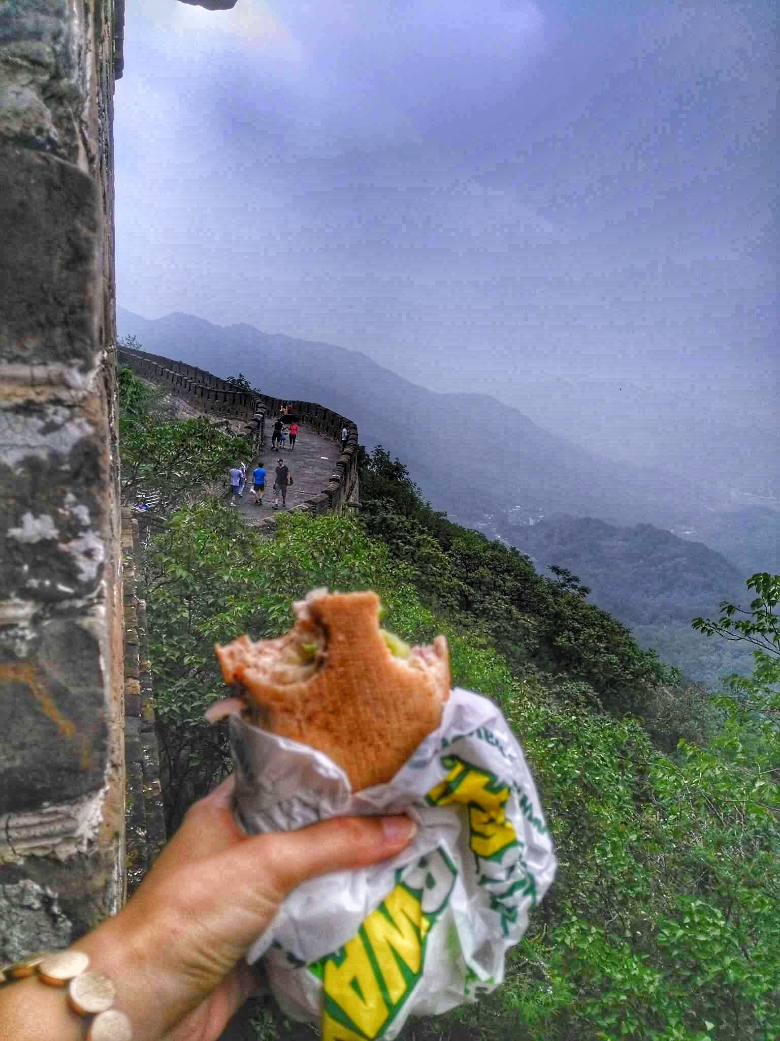 Eating Subway Sandwich at Mutianyu Great Wall, China